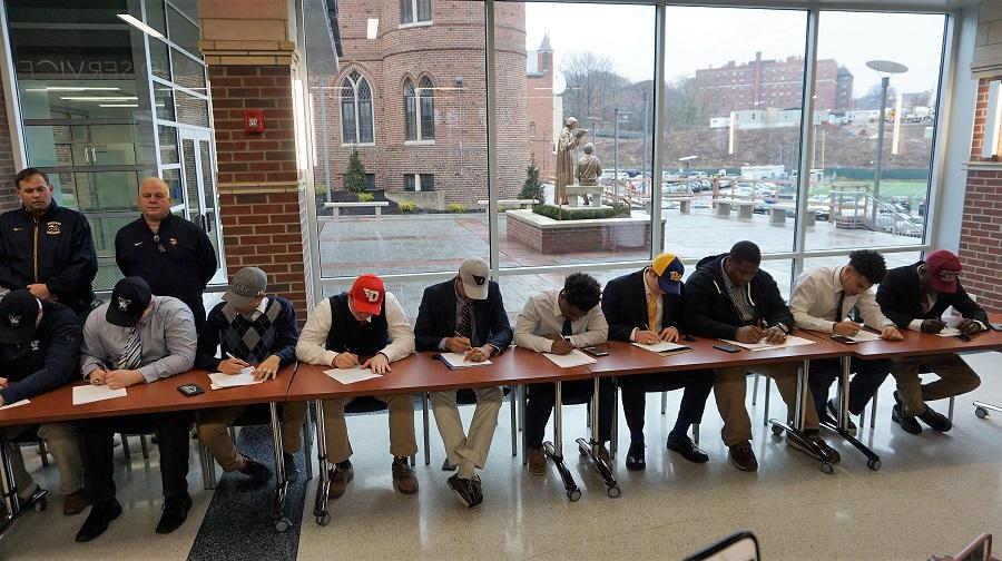 Students from the Class of '18 football players during National Signing Day
